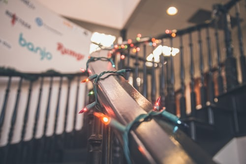 Lights wrapped around railing - Interior Decorating Service for the holiday season